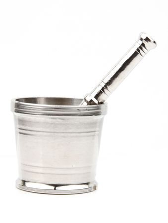 Traditional steel mortar and pestle on white background photo