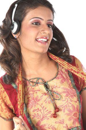 Smiling girl listening music photo