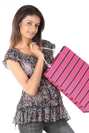Teenage girl returning from shop with shopping bags Stock Photo - 6665656