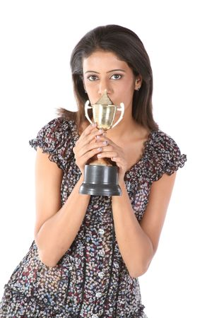 Teenage girl with the gold trophy photo