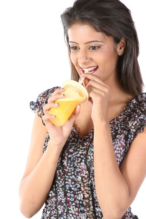 Happy young female sipping orange juice close up photo