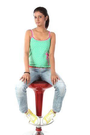 indian teenage girl relaxing on the chair photo