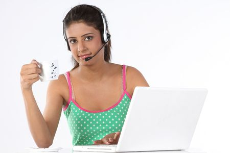 Indian teenage girl with laptop and headphones photo