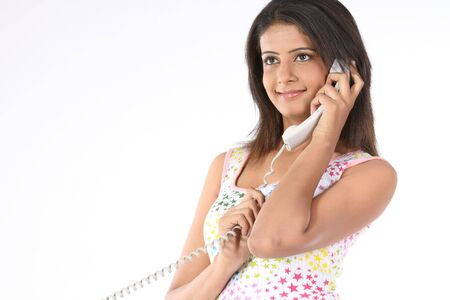 Indian slim girl talking with the telephone photo