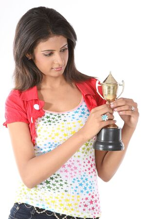 Teenage girl looking her gold trophy Stock Photo - 6624389