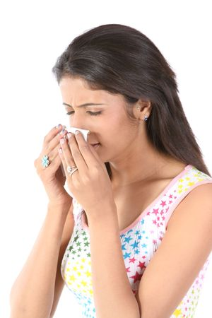 Indian slim girl sneezing with tissue paper photo
