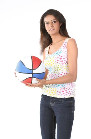 Indian woman in pants holding basket ball photo