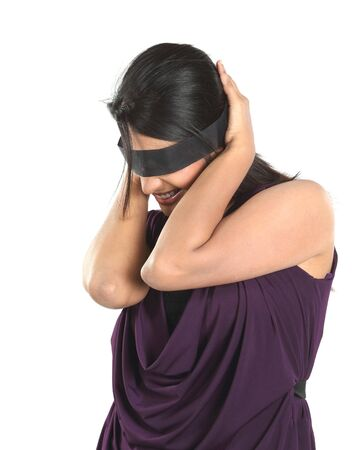 Businesswoman shutting her eyes with black band photo