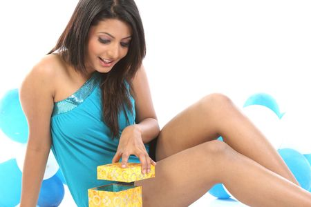 indian girl with balloons and present box photo