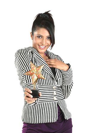 Teenage modern girl with star winning trophy Stock Photo - 6534575