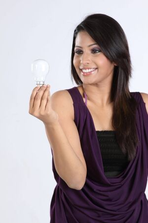 Smiling girl with bulb photo
