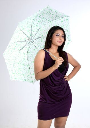 Smiling girl standing with umbrella photo