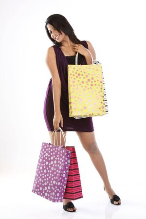 Indian modern girl with shopping bags photo
