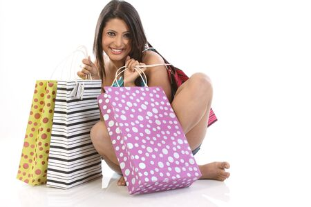 teenage girl seeing all her shopping bags happily Stock Photo - 6600843