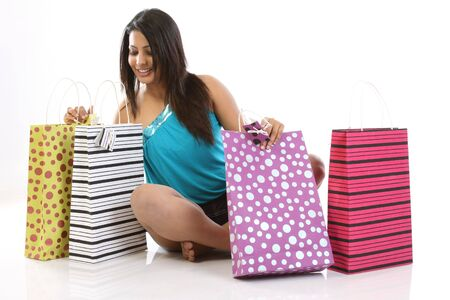 teenage girl seeing all her shopping bags happily