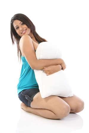 Beautiful woman hugging the soft pillow photo