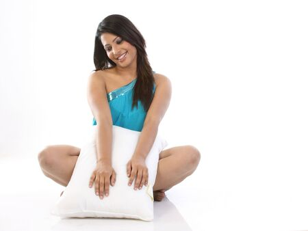 young woman in jolly mood with pillow photo