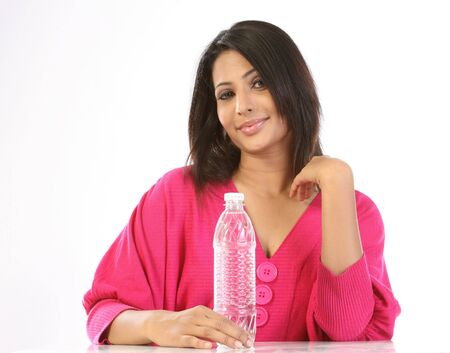Teenage girl having water bottle on the table Stock Photo - 6600851