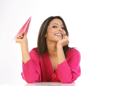 college girl holding pink paper plane Stock Photo