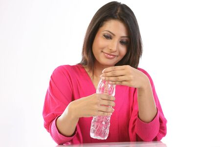 woman  drinking mineral water in a plastic bottle Stock Photo - 6570730