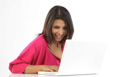 beautiful indian girl face: Woman using laptop Stock Photo