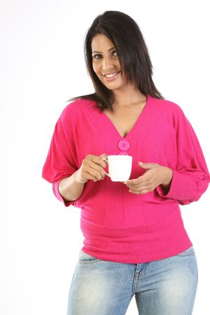 College girl holding cup of coffee photo