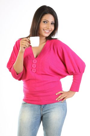 teenage girl with jeans pants and pink top holding the cup photo