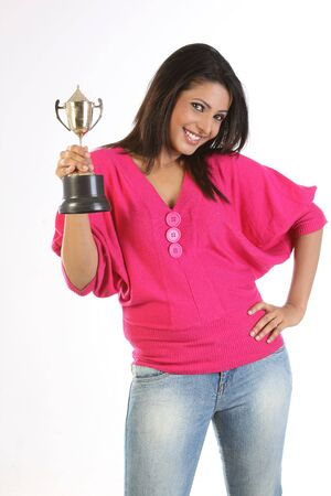 girl holding the winning gold trophy photo