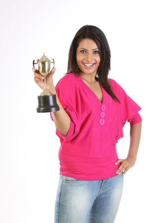 college girl holding the winning gold trophy Stock Photo - 6561484