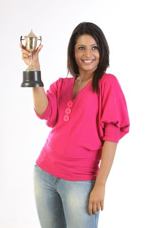 college girl holding the winning gold trophy photo