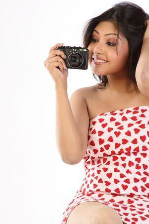 Young women with camera, white background photo