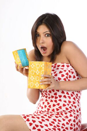 Surprised woman opening the gift box photo