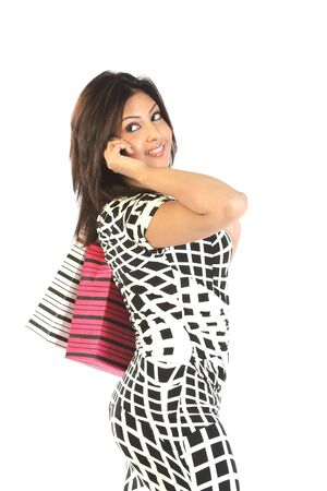 girl with bags speaking over cellphone Stock Photo - 6561377