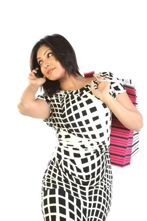 woman with shopping bags using a mobile phone. Stock Photo - 6555924