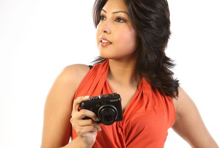 Young woman with digital camera photo