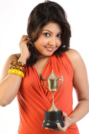 woman with gold trophy Stock Photo - 6545514