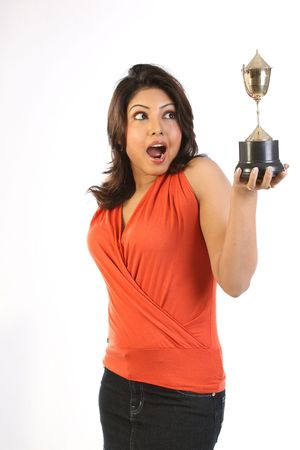 Indian woman with gold trophy photo