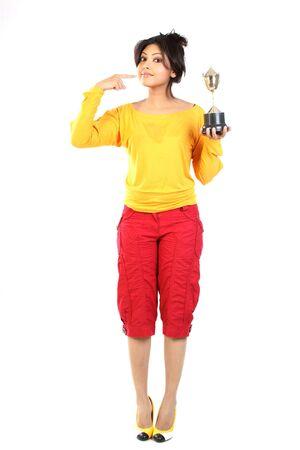 Beautiful girl showing her gold trophy photo