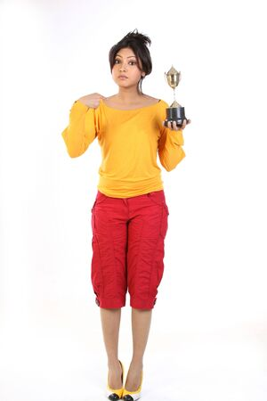 Beautiful teenage girl with gold trophy Stock Photo - 6561535