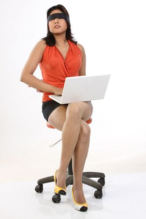 Woman tied black band sitting with laptop photo