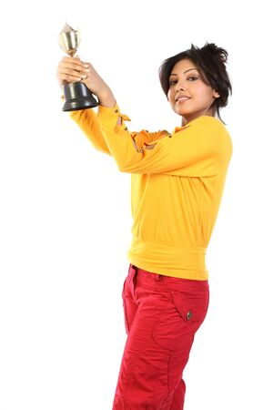 Young woman feeling happy with the gold trophy  Stock Photo - 6561557