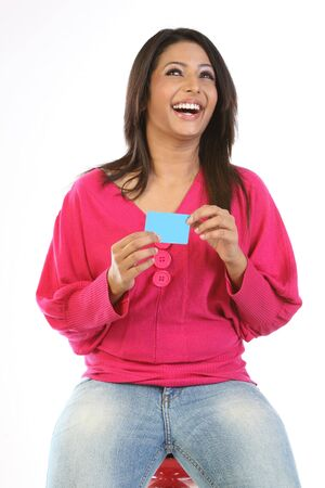 Smiling woman with  blue blank  card photo