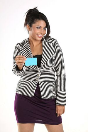 overcoat: Girl with overcoat holding blue credit card