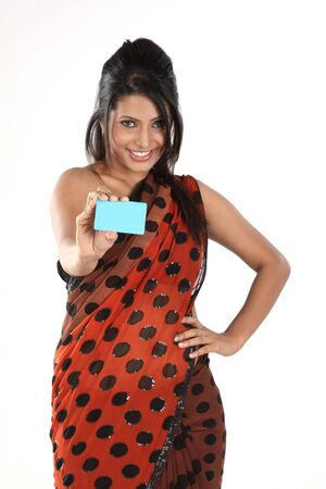 Asian girl in sari with blue credit card Stock Photo - 6560573