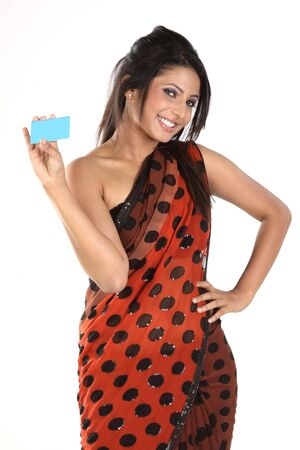 Indian girl in sari holding blue blank credit card photo