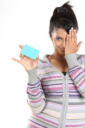 Teenage girl with blue blank credit card photo