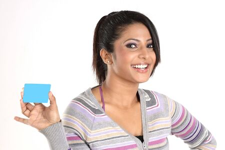 Smiling girl with blue credit card photo