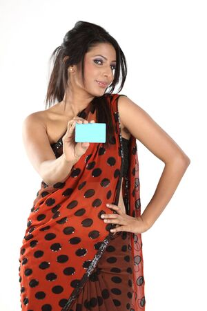 Teenage girl in dots sari with blue credit card photo