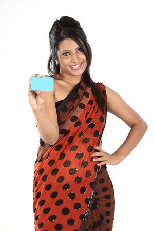 Beautiful woman in sari holding blue blank card photo