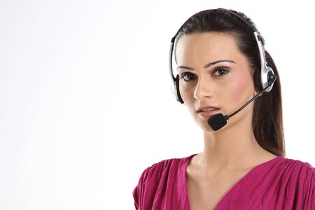 handsfree phone: Indian woman with headphones